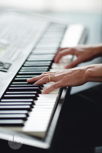 closeup of hands on piano