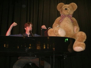 teddy bear on piano
