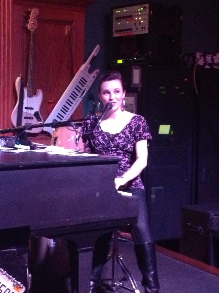 katie pinder brown performing at piano