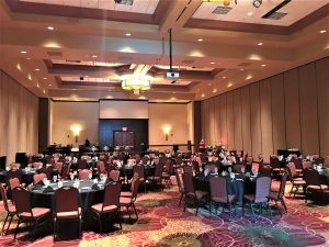 Ballroom setup for a corporate event hosted at the Bloomington-Normal Marriott.